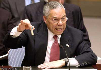 Powell holding a bottle of anthrax or Bush cocaine