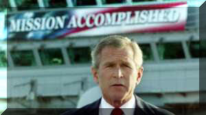 Bush with Mission Accomplished sign behind him