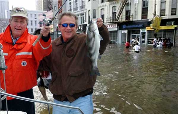 War Criminals on a boat fishing the streets of New Orleans shortly after Hurricane Katrina.  Junior smiles and displays a caught fish, while U.S. citizens walk in (sic) 'waste' deep water covering the streets