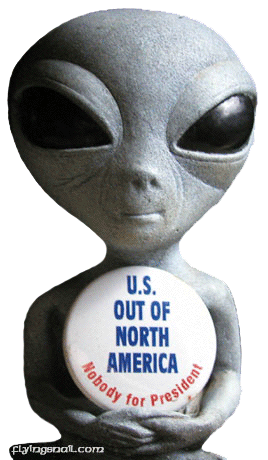 Picture of ET holding a sign that says, U.S. OUT OF NORTH AMERICA, Nobody for President