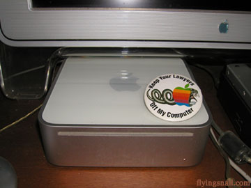 """Keep Your Lawyers Off My Computer"" button on top of a Mac Mini"