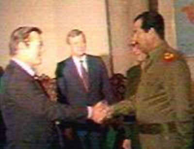 Rummy and Saddam shaking hands photo