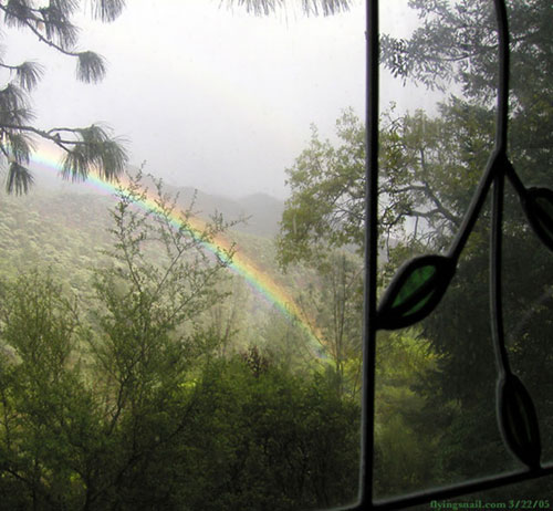 Kitchen Window, Rainbow in canyon below.